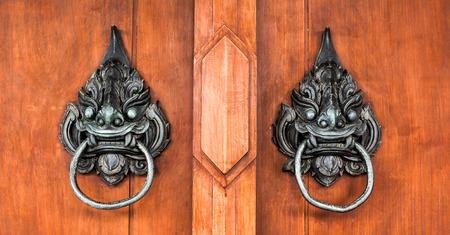 large doors: old thai handle the door Stock Photo