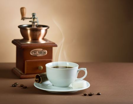 Hot Coffee and coffee grinder photo