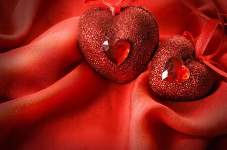 Red Valentine Hearts on a red silk photo
