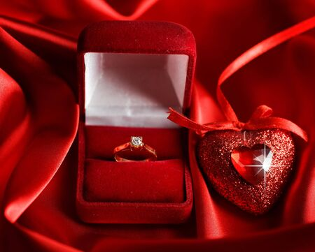 Valentine Heart and Diamond ring on a red silk photo