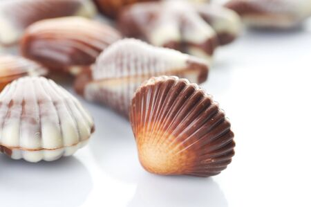 Swiss Chocolate Seashells isolated on white photo