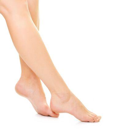 Beautiful woman legs over white photo