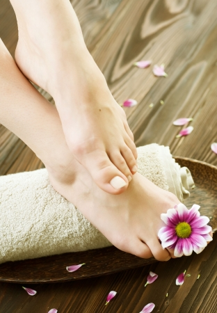 Beautiful Woman Feet with flower.Spa or pedicure concept photo