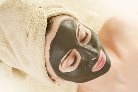 Spa Mud Mask on the womans face photo