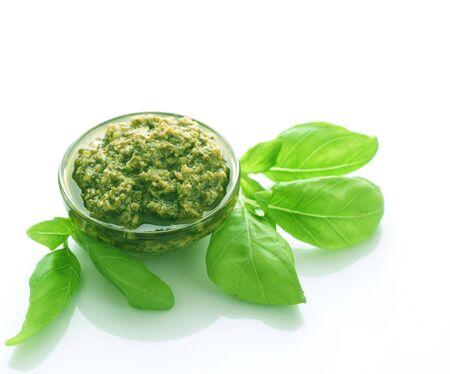 Italian Pesto sauce and fresh basil isolated on white photo