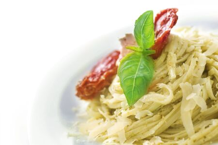 Italian Pasta with Pesto sauce,olives,basil and dried tomato Stock Photo - 6742120