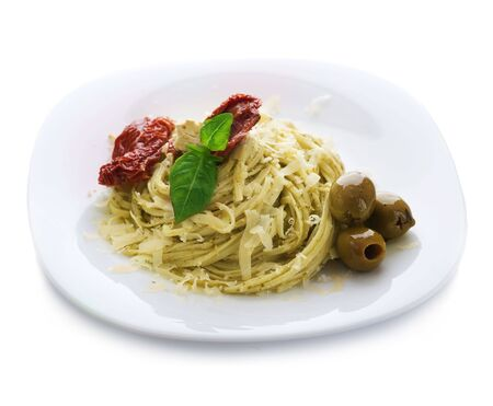 Italian Pasta with Pesto sauce,olives,basil and dried tomato Stock Photo - 6742112