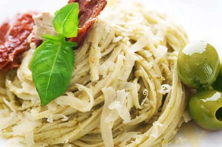 Italian Pasta with Pesto sauce,olives,basil and dried tomato Stock Photo - 6742115