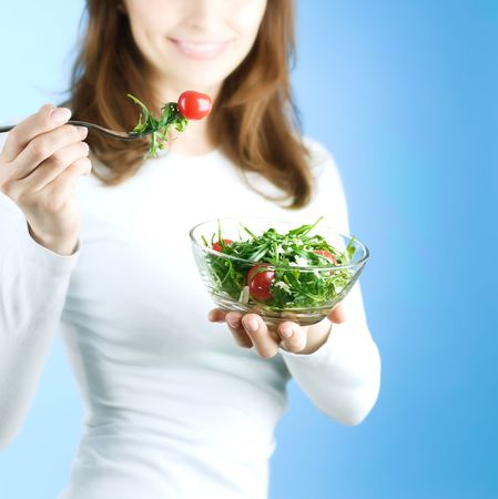 Dieting Concept.Happy Young Woman eating vegetable salad Stock Photo - 7861955