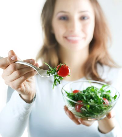 Dieting Concept.Happy Young Woman eating vegetable salad Stock Photo - 7861956