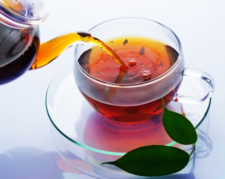 brown cup tea: Pouring Tea
