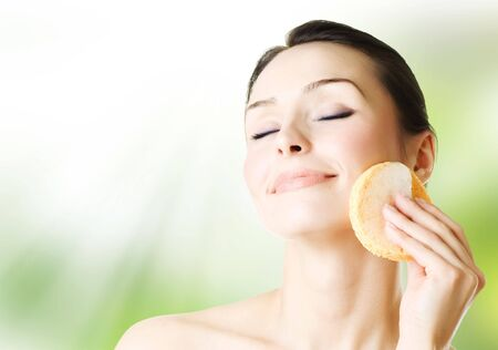 facial cleansing: Young Woman Washing her Face Stock Photo