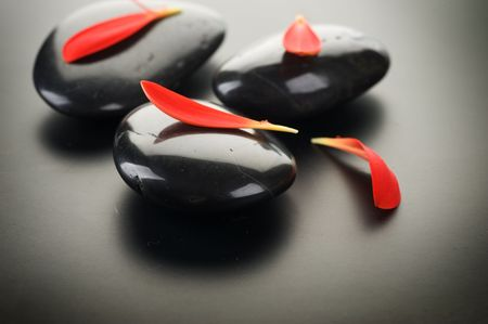 tranquil: Zen Spa Stones over black.With copy space Stock Photo