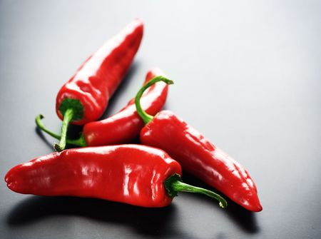 hot peppers: Red Hot Chili Peppers over black