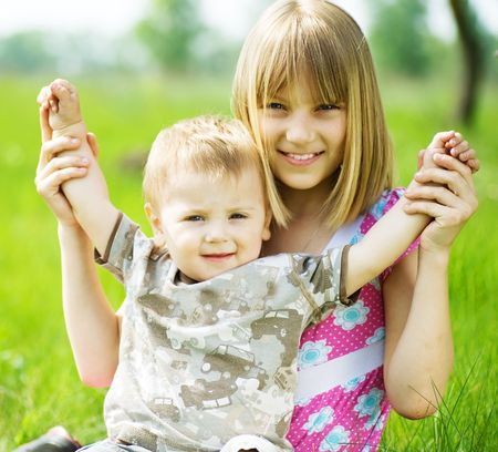 Happy Kids-sister and brother having fun outdoor Stock Photo - 6987807