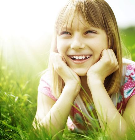 Happy little Girl in a park.Close-up portrait photo
