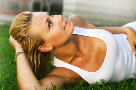 Beautiful Girl lying on the grass photo