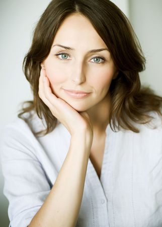 eyeing:  Portrait of a cute cheerful young woman Stock Photo