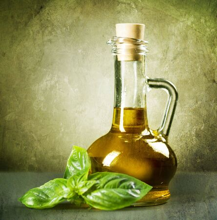 european cuisine: Olive Oil with fresh Basil.Vintage Styled Stock Photo