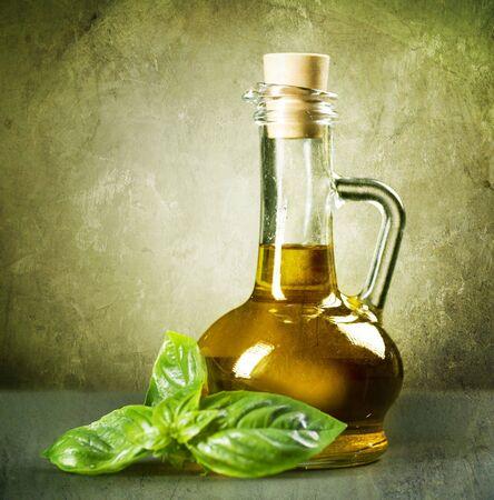 basils: Olive Oil with fresh Basil.Vintage Styled Stock Photo