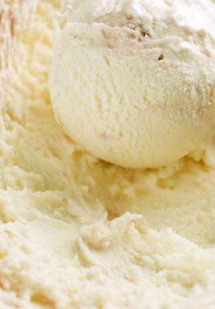 Vanilla ice cream with strawberry pieces photo
