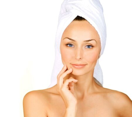 touched: Beautiful Young Woman with bath towel over white.Spa