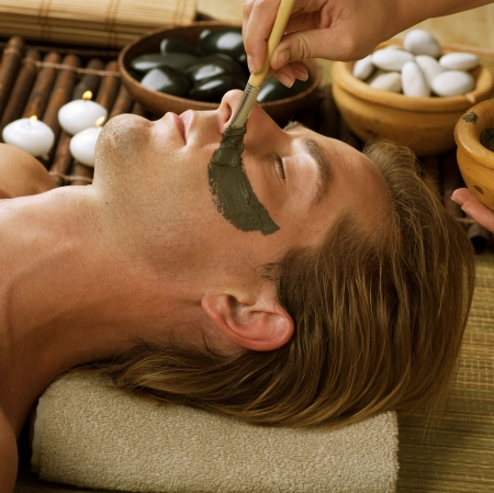 male facial: Spa.Handsome Man with a Mud Mask on his Face