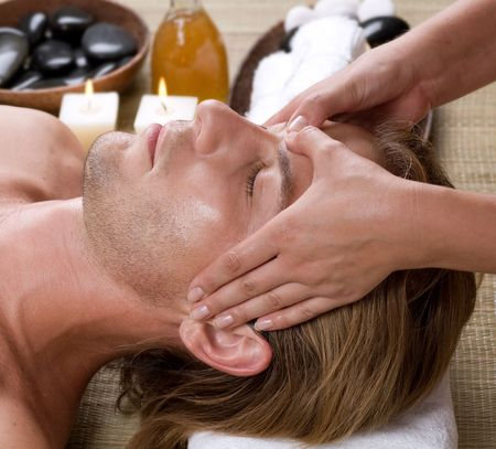 cleanse: Spa. Young Man getting Face Massage.