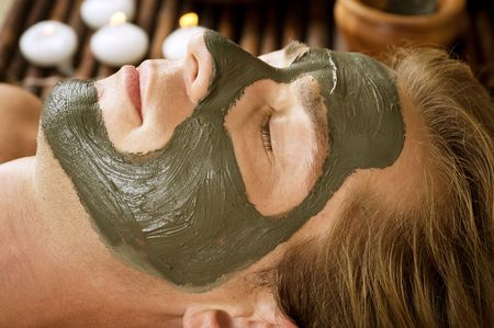 Spa. Handsome Man with a Mud Mask on his Face  Stock Photo - 8720786