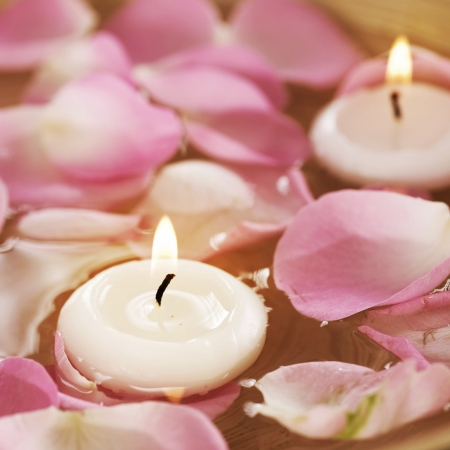 candles spa: Spa floating Candles and rose Petals in water  Stock Photo