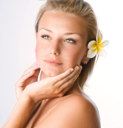 frangipanis: Beautiful Spa Girl face. Perfect clear skin concept