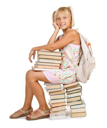 Back to School concept. School Girl sitting on the stack of books photo