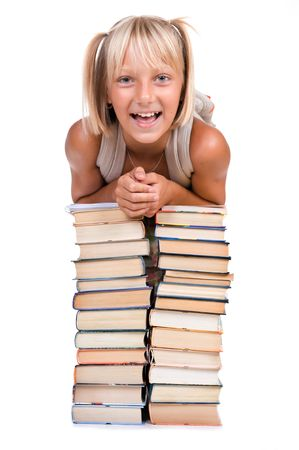 Back to School concept. School Girl above the heap of books photo