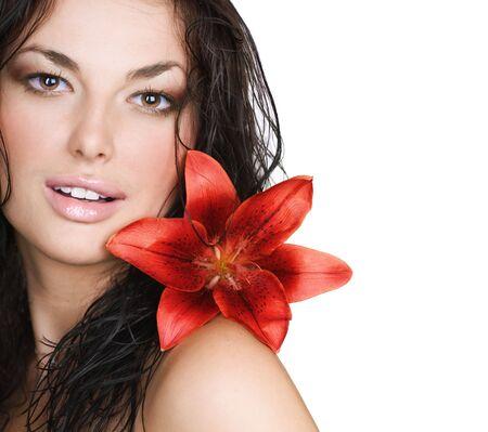 Hermosa joven Sexy con flor Foto de archivo