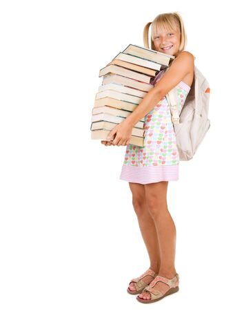 Back to School.Little Schoolgirl with heavy books photo