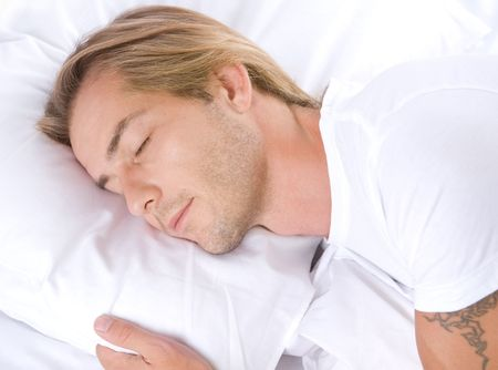 Handsome Man Sleeping in his Bed Stock Photo - 7683382