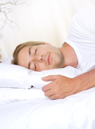 Young Man Sleeping in his Bed Stock Photo - 7683380