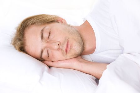 Handsome Man Sleeping in his Bed Stock Photo - 7683383