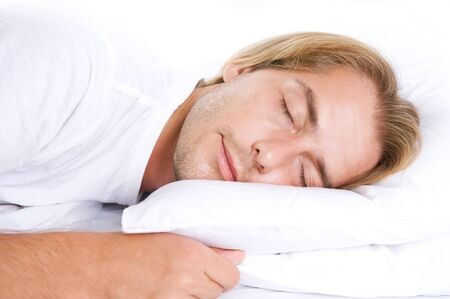 Young Man Sleeping in his Bed Stock Photo - 7683082