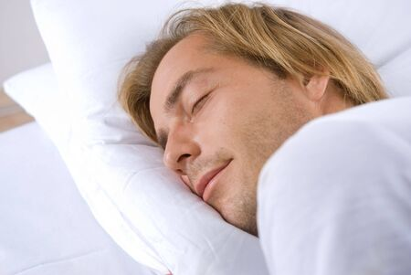 Young Man Sleeping in his Bed Stock Photo - 7683386