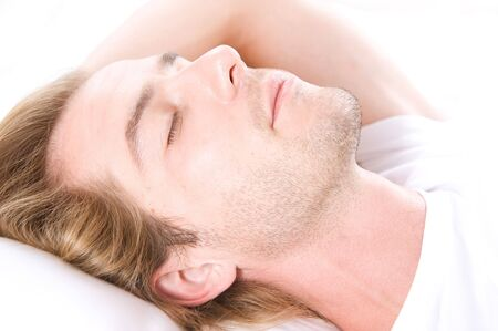 Handsome Man Sleeping in his Bed Stock Photo - 7683391