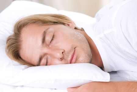 Young Man Sleeping in his Bed Stock Photo - 7683083
