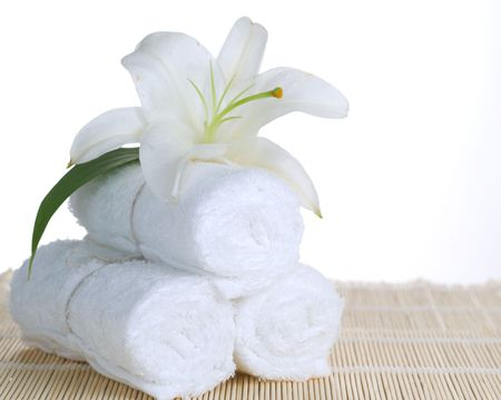 spa towels: Spa setting over white
