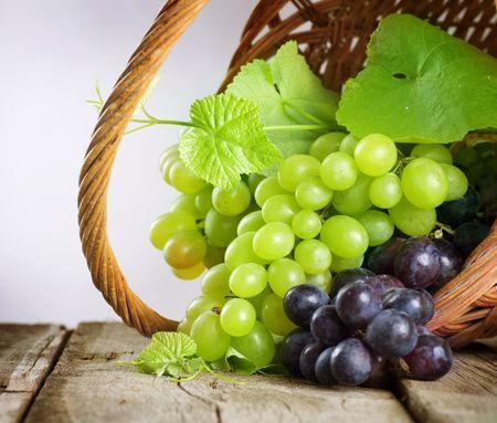 Grape.Grapevine over vineyard background  photo