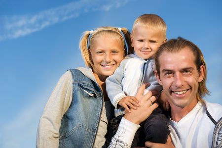 Healthy Family Outdoor.Happy Father with Kids over blue sky photo