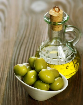 Olive Oil with Olives over white Stock Photo - 7815196