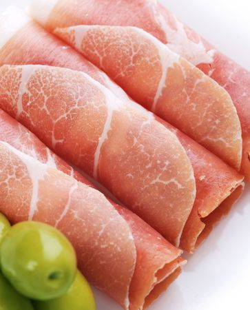 Fresh prosciutto rolls closeup  photo