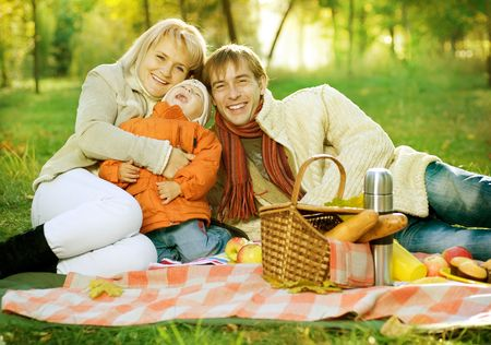 Picnic in Autumn Park. Happy Family outdoor  photo