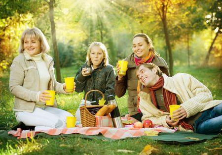 Picnic.Happy Family in Autumn Park  photo