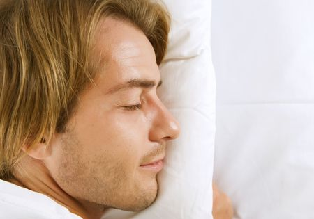 Young Man Sleeping in his Bed photo